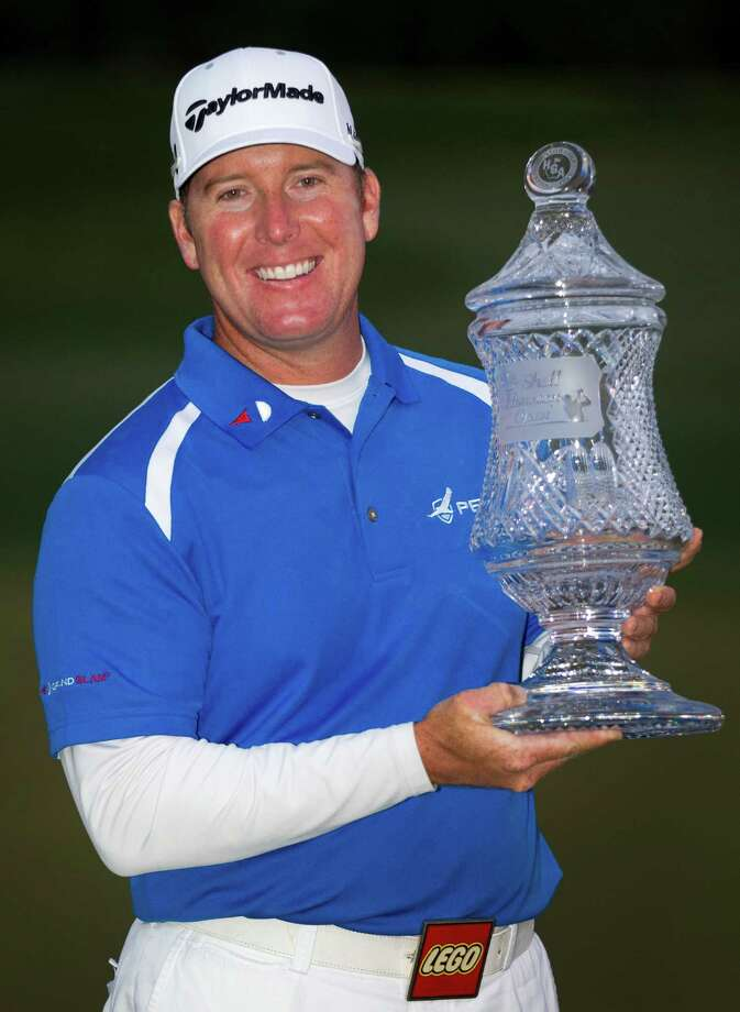 D.A. Points holds the Shell Houston Open trophy after winning the tournament with a 16-under-oar 272 at the Redstone Tournament Course Sunday, March 31, 2013, in Humble. Photo: Brett Coomer, Houston Chronicle / © 2013 Houston Chronicle