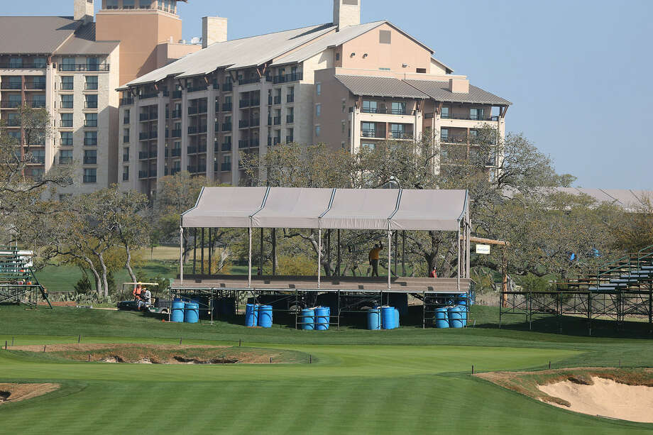 Bleachers and tents were being built around the 16th green at AT&T Oaks Course at TPC San Antonio last week in preparation for this week's Valero Texas Open. Photo: Jerry Lara / San Antonio Express-News