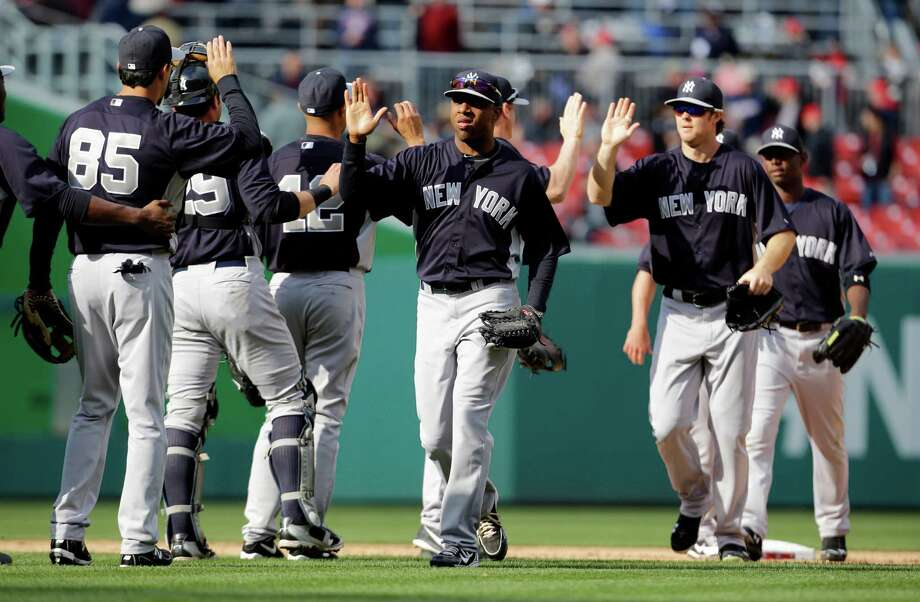 The New York Yankees celebrate after an exhibition baseball game against the Washington Nationals at Nationals Park, Friday, March 29, 2013, in Washington. The Yankees won 4-2. (AP Photo/Alex Brandon) Photo: Alex Brandon