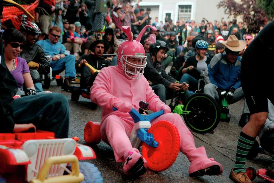 An Easter bunny heads down Vermont Street for Bring Your Own Big Wheel on March 31, 2013 in San Francisco. Bring Your Own Big Wheel is an Easter Sunday event where participants risk humiliation and serious injury racing their big wheels down the crazy-curvy Vermont & 20th streets. Photo: Jessica Olthof, The Chronicle / ONLINE_YES