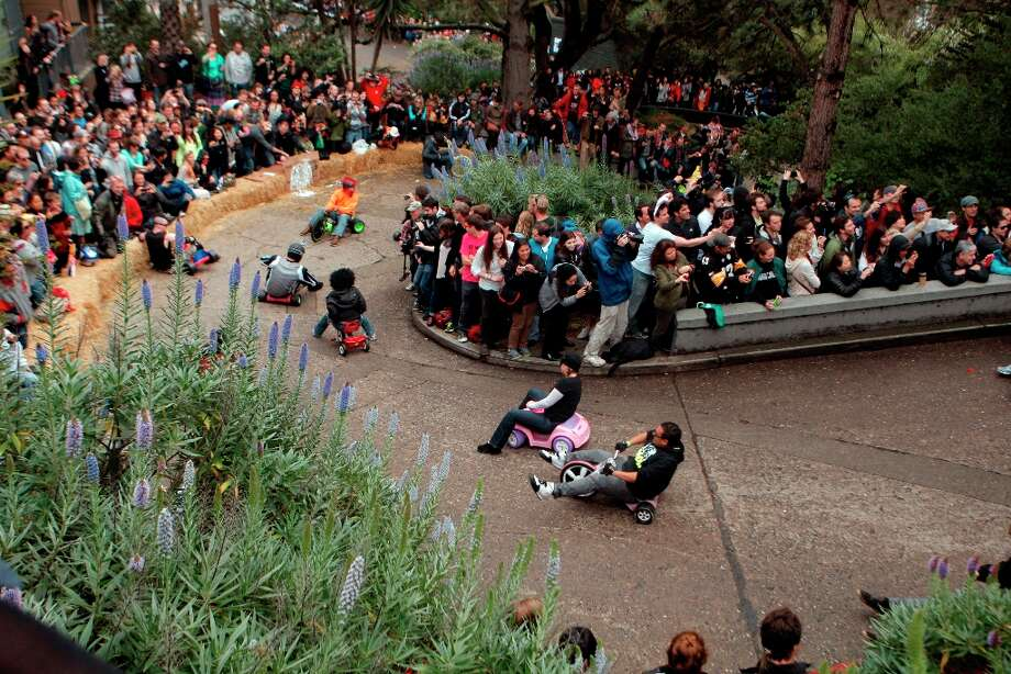 Bring Your Own Big Wheel racers heading down Vermont Street for Bring Your Own Big Wheel on March 31, 2013 in San Francisco. Bring Your Own Big Wheel is an Easter Sunday event where participants risk humiliation and serious injury racing their big wheels down the crazy-curvy Vermont & 20th streets. Photo: Jessica Olthof, The Chronicle / ONLINE_YES