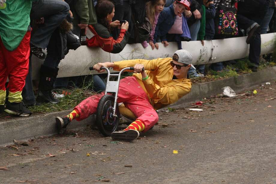A Bring Your Own Big Wheel racer crashes into the curb on Vermont Street on March 31, 2013 in San Francisco. Photo: Jessica Olthof, The Chronicle / ONLINE_YES