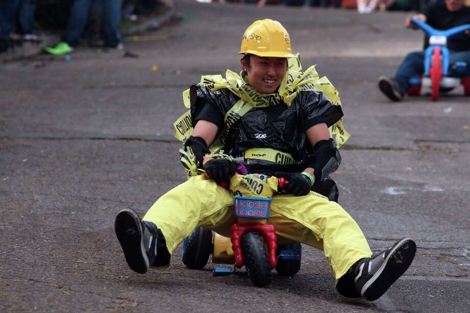Sho Takahashi racing down Vermont Street for Bring Your Own Big Wheel on March 31, 2013 in San Francisco. Photo: Jessica Olthof, The Chronicle / ONLINE_YES