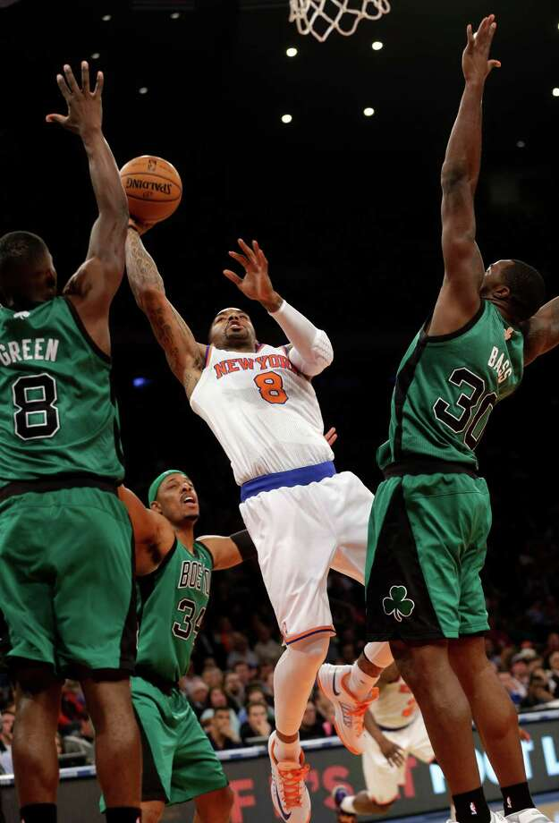 New York Knicks' J.R. Smith, center, puts up a shot past Boston Celtics defense during the first half of an NBA basketball game at Madison Square Garden Sunday, March 31, 2013 in New York.  (AP Photo/Seth Wenig) Photo: Seth Wenig