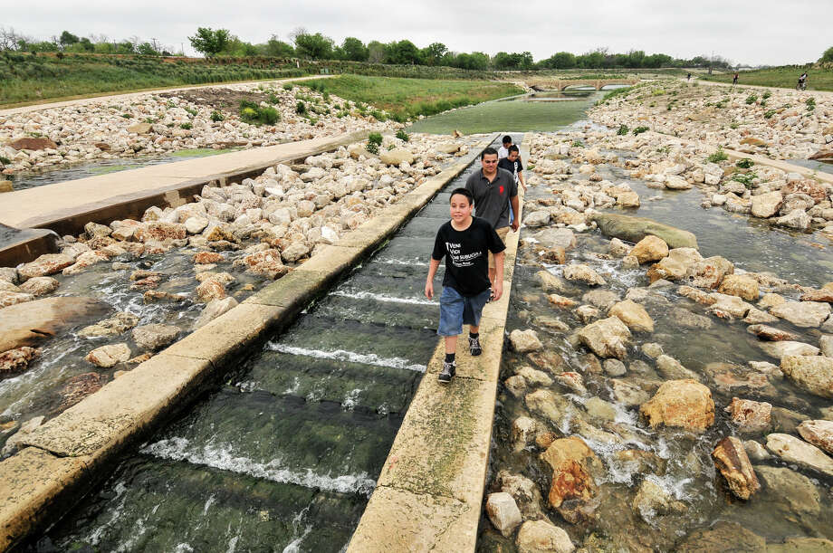Edgar Fuentes (from front), Eduardo Fuentes, Roxanne Estala and George Estala explore the recently completed portion of the Mission Reach section at Padre Park Sunday morning, March 31, 2013. Photo: Robin Jerstad, For The San Antonio Express-News