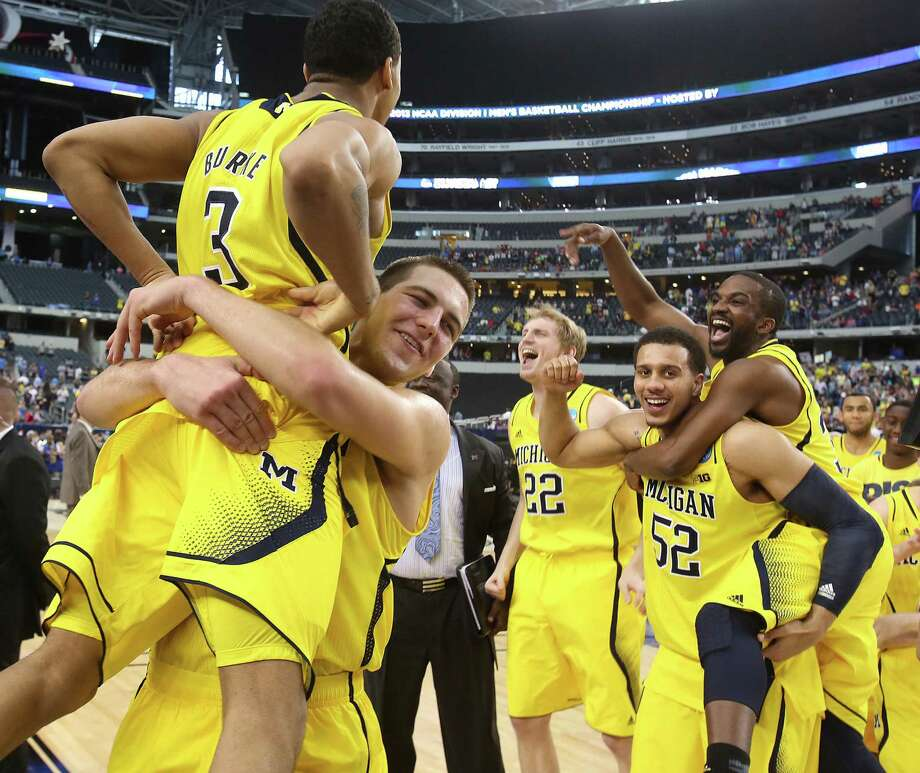 Michigan players, including star Trey Burke (left), rejoice after blowing out Florida on Sunday. The Wolverines are headed to the Final Four for the first time in 20 years. Photo: Stephen M. Dowell / McClatchy-Tribune News Service