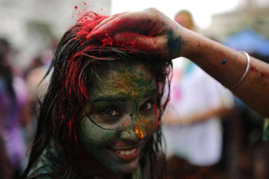 "A Hindu covered in coloured powders celebrate ""Holi"" at a temple in Kuala Lumpur on March 31, 2013. Holi, the festival of colours where people smear each other with coloured powder and water, is celebrated by Hindus across the country. AFP PHOTO / MOHD RASFANMOHD RASFAN/AFP/Getty Images Photo: Mohd Rasfan, AFP/Getty Images"
