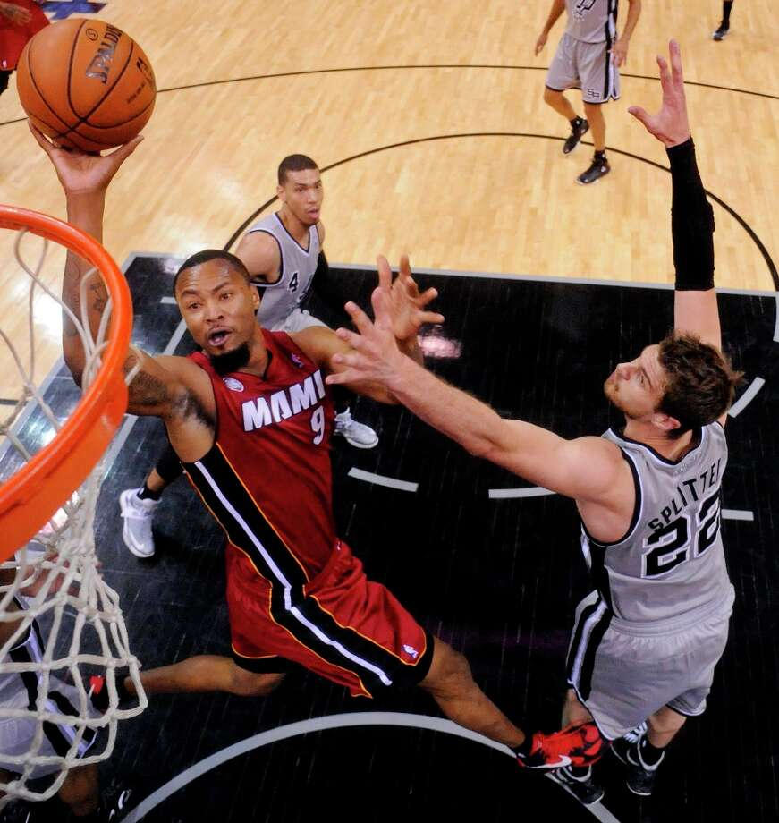 The Miami Heat's Rashard Lewis shoots against Spurs' Tiago Splitter during first half action Sunday, March 31, 2013 at the AT&T Center. The Heat won 88-86. Photo: Edward A. Ornelas, San Antonio Express-News / © 2013 San Antonio Express-News