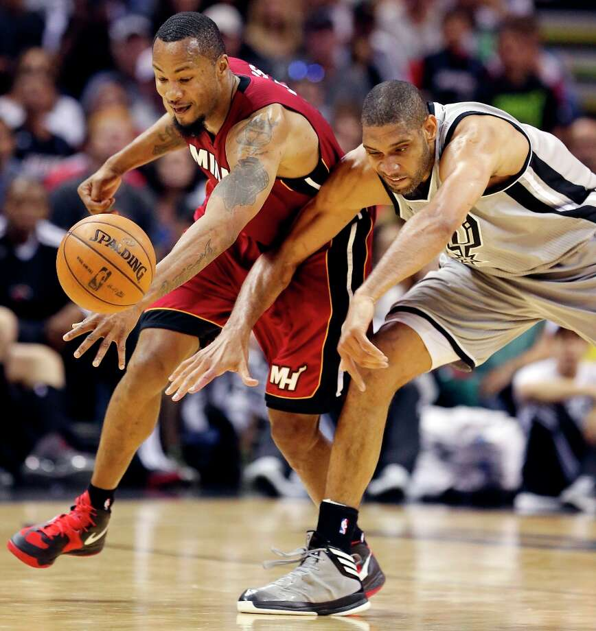 The Miami Heat's Rashard Lewis and Spurs' Tim Duncan grab for a loose ball during second half action Sunday, March 31, 2013 at the AT&T Center. The Heat won 88-86. Photo: Edward A. Ornelas, San Antonio Express-News / © 2013 San Antonio Express-News