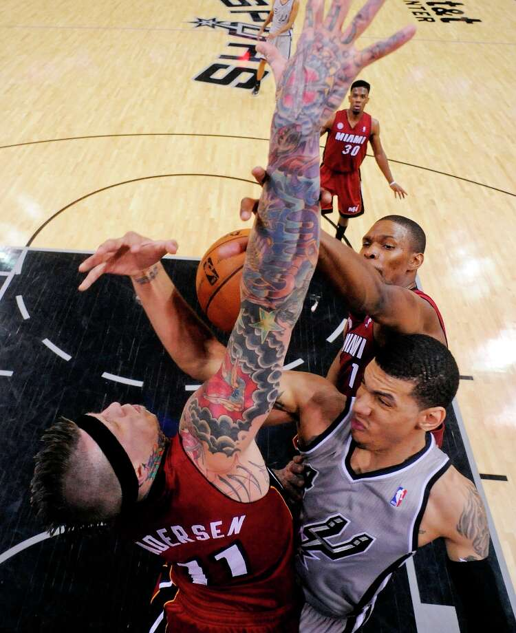 The Spurs' Danny Green is defended by Miami Heat's Chris Andersen and Chris Bosh during second half action Sunday, March 31, 2013 at the AT&T Center. The Heat won 88-86. Photo: Edward A. Ornelas, San Antonio Express-News / © 2013 San Antonio Express-News