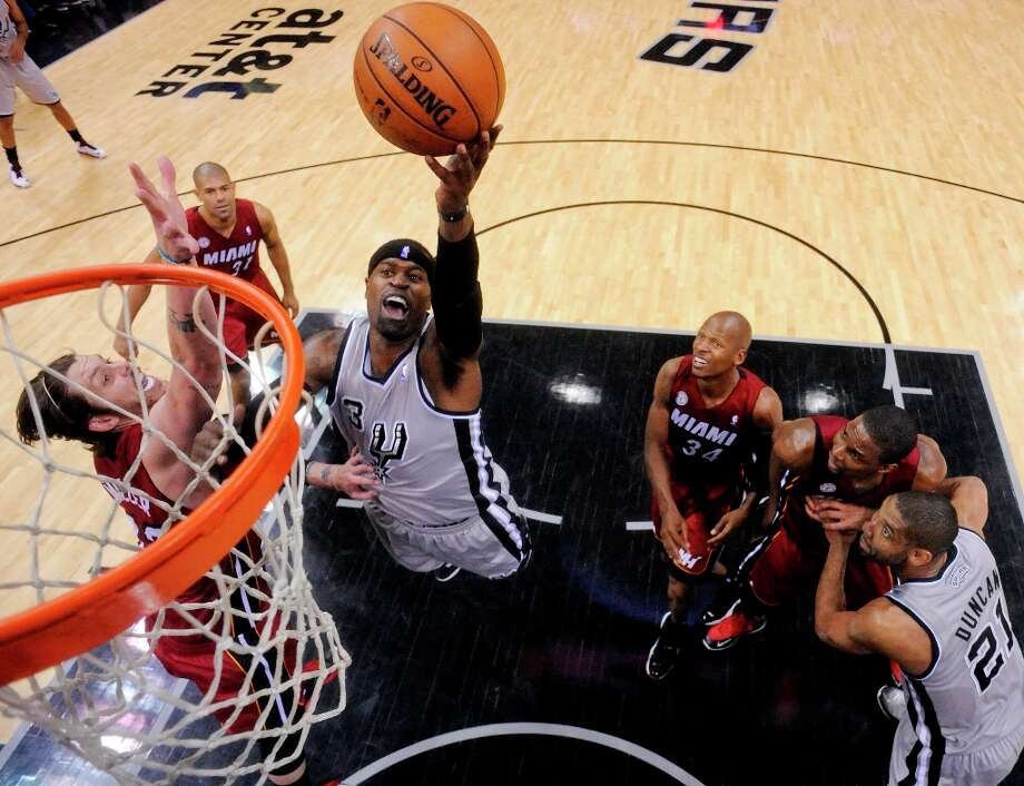 The Spurs' Stephen Jackson shoots around Miami Heat's Mike Miller during second half action Sunday, March 31, 2013 at the AT&T Center. The Heat won 88-86. Photo: Edward A. Ornelas, San Antonio Express-News / © 2013 San Antonio Express-News