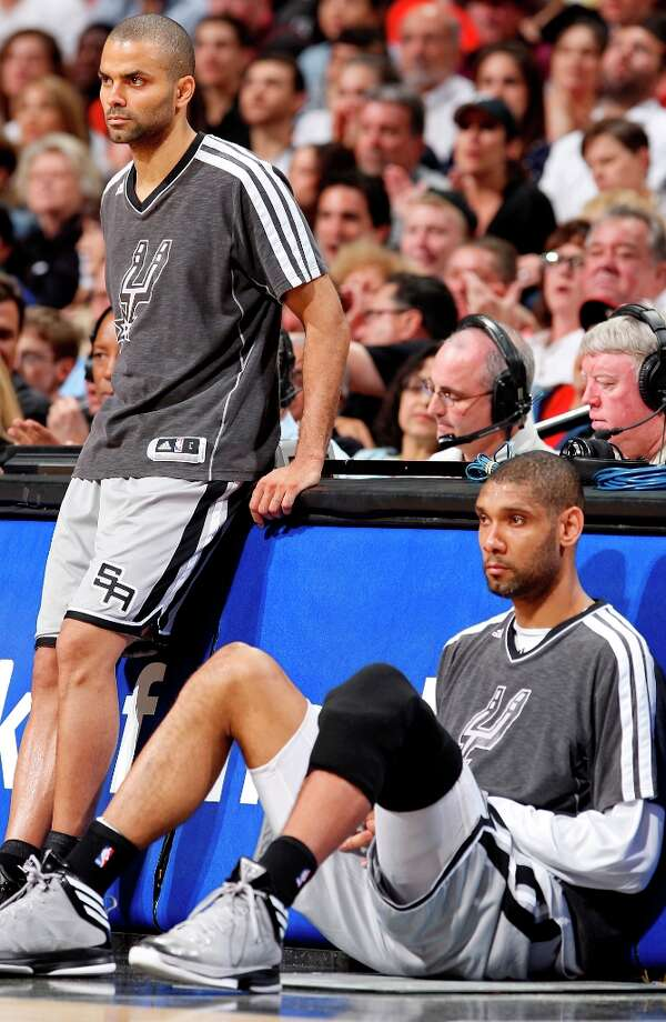 The Spurs' Tony Parker and Tim Duncan wait to check into the game during second half action Sunday, March 31, 2013 at the AT&T Center. The Heat won 88-86. Photo: Edward A. Ornelas, San Antonio Express-News / © 2013 San Antonio Express-News