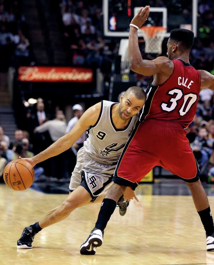 The Spurs' Tony Parker looks for room around Miami Heat's Norris Cole during second half action Sunday, March 31, 2013 at the AT&T Center. The Heat won 88-86. Photo: Edward A. Ornelas, San Antonio Express-News / © 2013 San Antonio Express-News