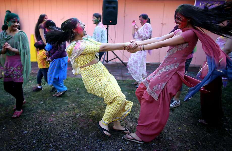 Bhavya Kumar, left, and Priyonka Golen dance during a Holi celebration on Saturday, March 30, 2013 at Sanatan Dharma Temple and Cultural Center in Maple Valley, Wash.  (AP Photo/seattlepi.com, Joshua Trujillo) Photo: Joshua Trujillo, Associated Press