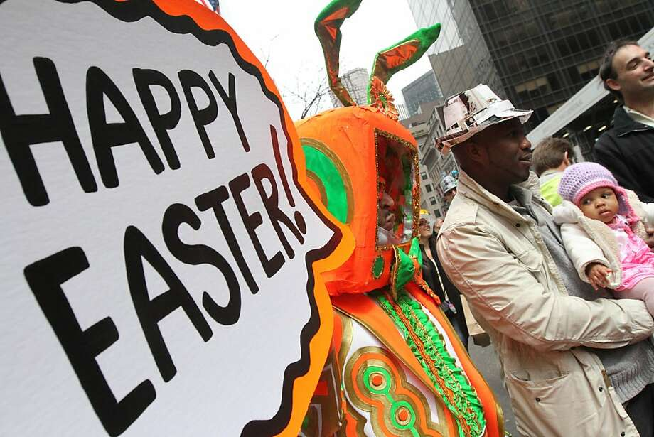 Six month old Leilani Oku, right, is held by her father Dean Oku, as they stop to be photographed with Davey Mitchell, left, as they take part in the Easter Parade Sunday March 31, 2013 on New York's Fifth Avenue. (AP Photo/Tina Fineberg) Photo: Tina Fineberg, Associated Press