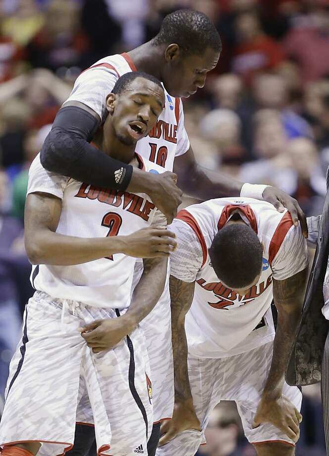 Louisville's Russ Smith (2), Gorgui Dieng (10) and Chane Behanan react to guard Kevin Ware's injury during the first half of the Midwest Regional final against Duke in the NCAA college basketball tournament, Sunday, March 31, 2013, in Indianapolis. (AP Photo/Michael Conroy) Photo: Michael Conroy, Associated Press