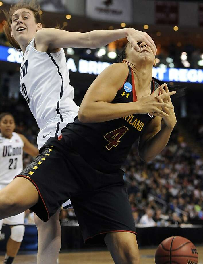 Connecticut's Breanna Stewart, left, fouls Maryland's Malina Howard during the second half of a regional semifinal game in the NCAA college basketball tournament in Bridgeport, Conn., Saturday, March 30, 2013. Connecticut won 76-50. (AP Photo/Jessica Hill) Photo: Jessica Hill, Associated Press