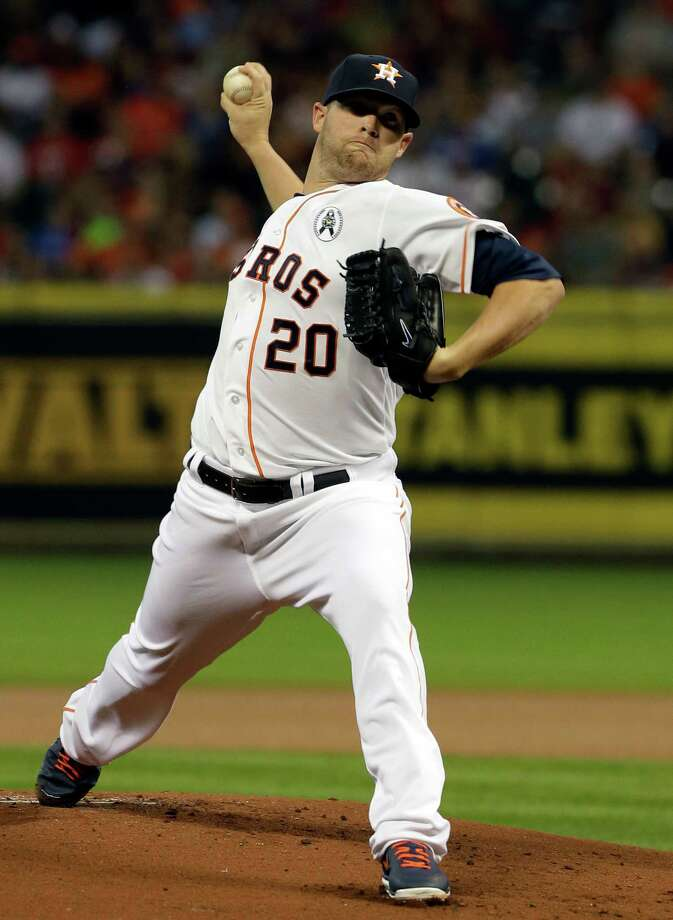 Houston Astros' Bud Norris (20) delivers against the Texas Rangers in the first inning of a season-opening baseball game, Sunday, March 31, 2013, in Houston. (AP Photo/Pat Sullivan) Photo: Pat Sullivan