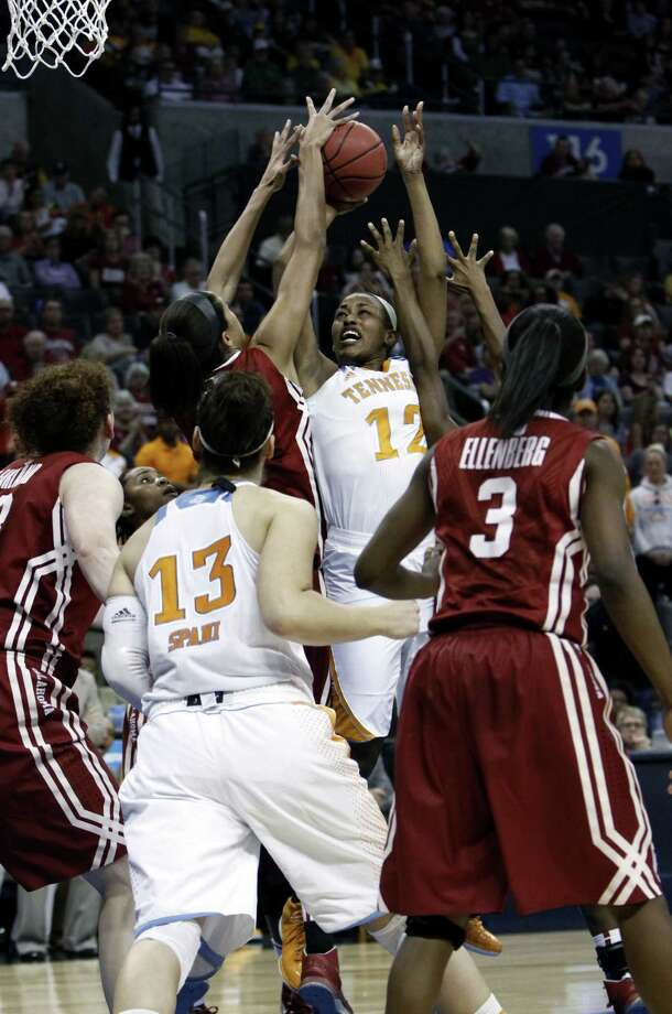 Tennessee's Bashaara Graves (12) shoots in the second half. Steele-ex Meighan Simmons, Tennessee's leading scorer, had five points. Photo: Alonzo Adams / Associated Press