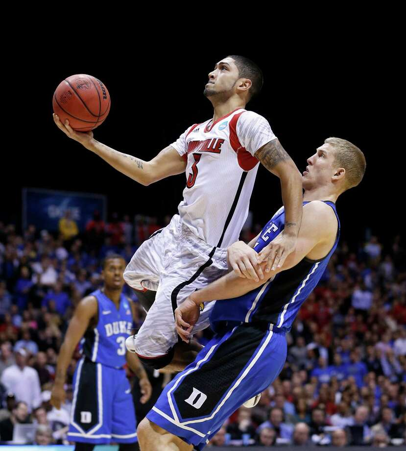 Good guard play from the likes of Peyton Siva, left, kept Louisville from being caught by Mason Plumlee and Duke on Sunday. Photo: Sam Riche / MCT
