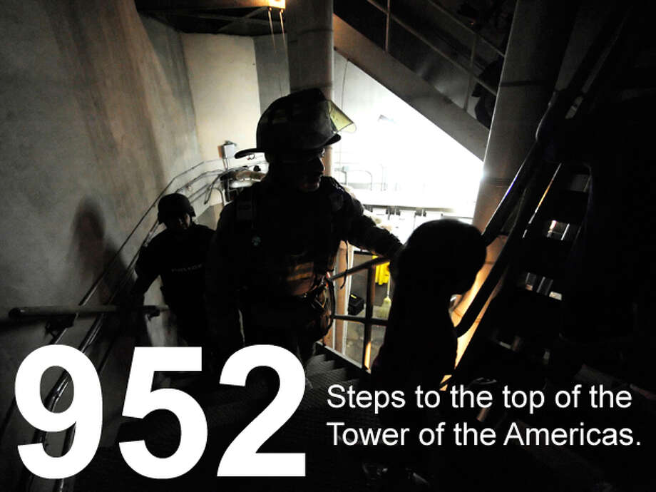 """Firefighters and police in full gear climb the steps at the Tower of the Americas during the Cystic Fibrosis Foundation """"Climb & Run"""" on Feb. 26, 2011. Billy Calzada / San Antonio Express-News Photo: San Antonio Express-News Photo Illustration"""