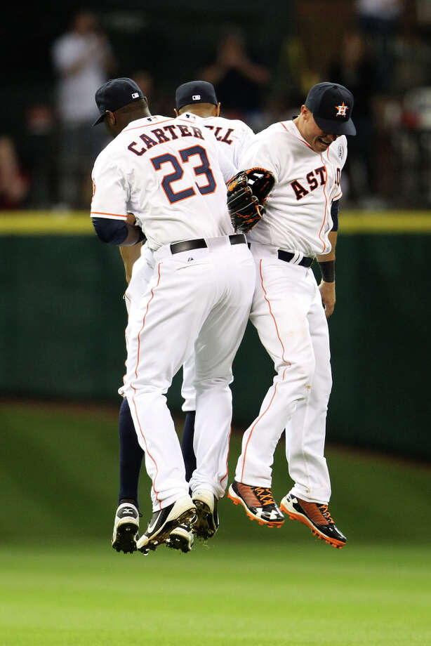 Chris Carter (23), Justin Maxwell (44), and Rick Ankiel (28) celebrate the win over the Rangers. Photo: Karen Warren, Houston Chronicle / © 2013 Houston Chronicle