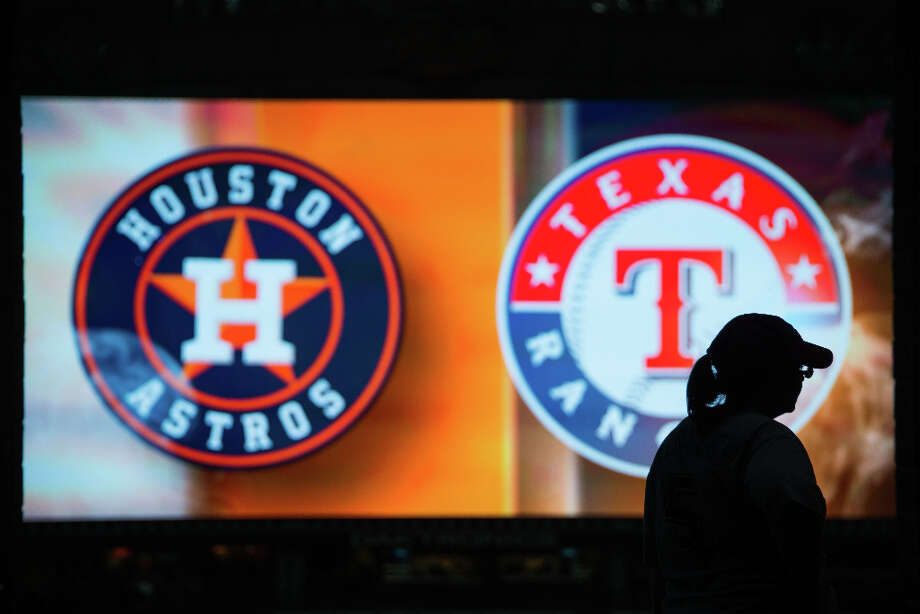 The logos of the Houston Astros and the Texas Rangers fill the video screen as fans arrive before the Astros season opener. Photo: Smiley N. Pool, Houston Chronicle / © 2013  Smiley N. Pool