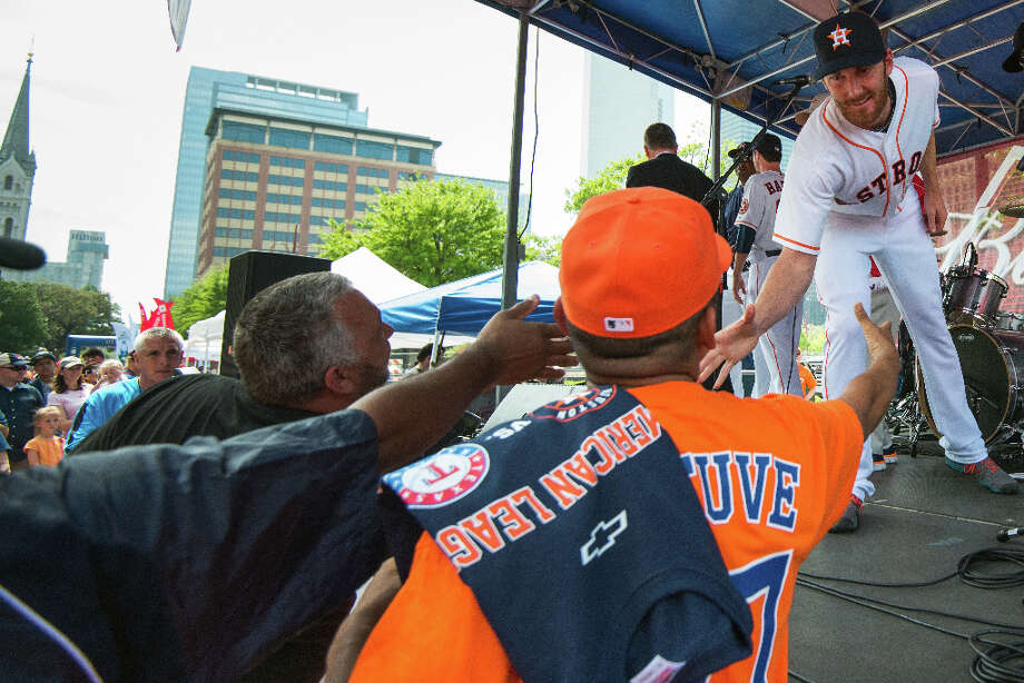 Astros starting pitcher Philip Humber shakes hands with fans before the season opener. Photo: Smiley N. Pool, Houston Chronicle / © 2013  Smiley N. Pool