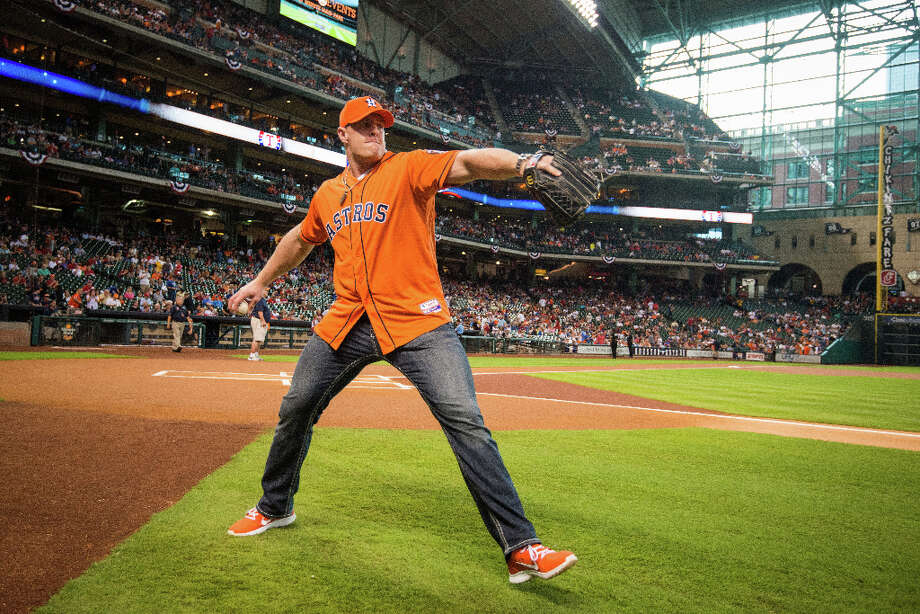Texans defensive end J.J. Watt warms up as he prepares to throw out the ceremonial first pitch before the season opener. Photo: Smiley N. Pool, Houston Chronicle / © 2013  Smiley N. Pool
