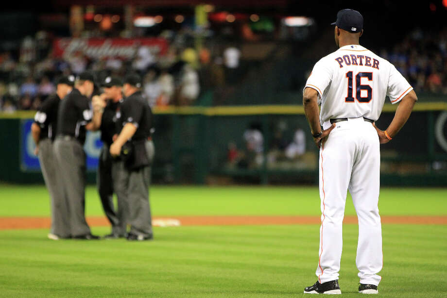 Astros manager Bo Porter watches the umpires confer as they determine whether Astros center fielder Justin Maxwell hit a triple or a home run during the fourth inning. Photo: Karen Warren, Houston Chronicle / © 2013 Houston Chronicle