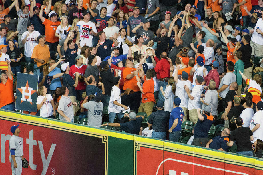 Rangers right field Nelson Cruz watches as a home run off the bat of Astros pinch hitter Rick Ankiel sails into the stands during sixth inning. Photo: Smiley N. Pool, Houston Chronicle / © 2013  Smiley N. Pool