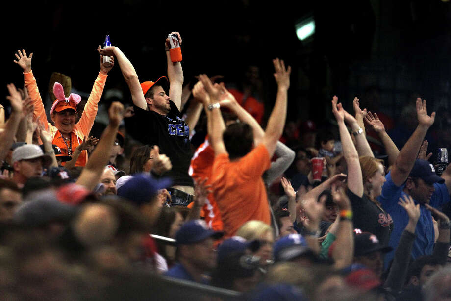 Fans do the wave during the seventh inning. Photo: Karen Warren, Houston Chronicle / © 2013 Houston Chronicle