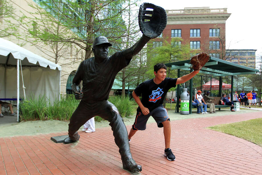 Angel Davila, 15, of Corpus Christi, poses for a photo next to the Jeff Bagwell statue during the street festival. Photo: Karen Warren, Houston Chronicle / © 2013 Houston Chronicle