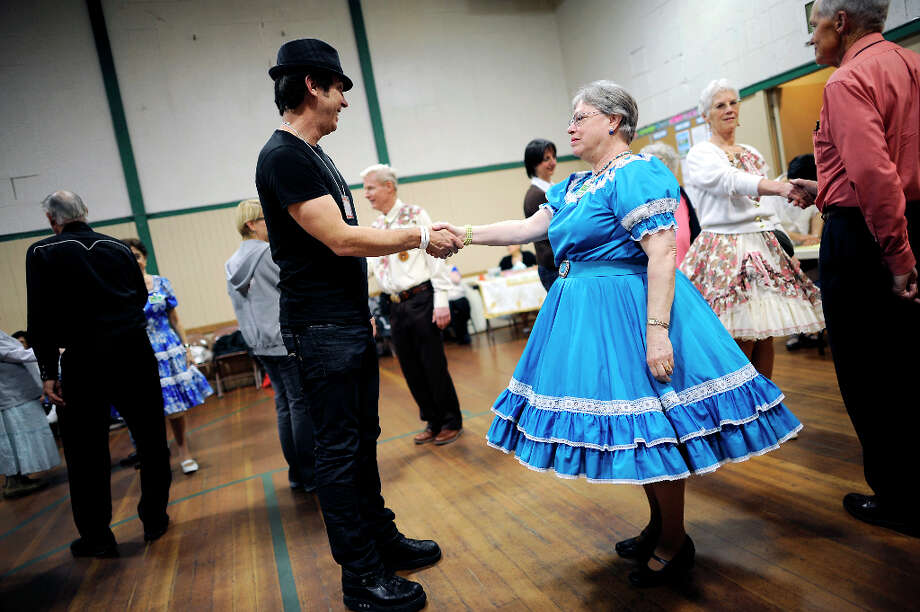 1st time square dancer Rob Cassidy(L) partners up with long time dancer Donna Campbell during the beginners lessons.  The Caper Cutters Square Dancing Club hosted their weekly dance and beginners lessons at St. Paul's Church in the Sunset District of San Francisco, Monday March 11th, 2013. Photo: Michael Short, Special To The Chronicle / ONLINE_YES