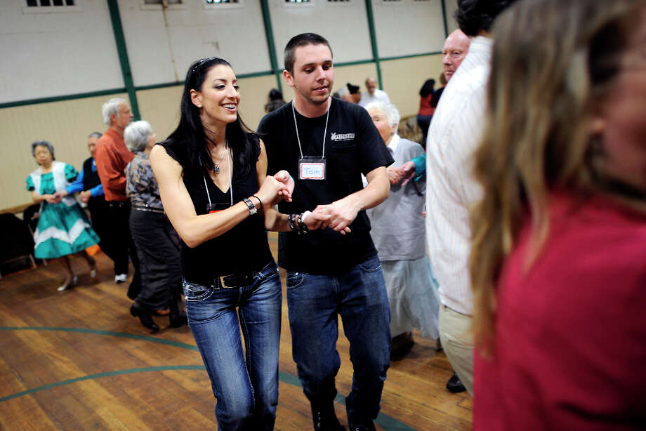 Beginning square dancers Alexandra Christ(L) and Tom Cassidy are seen promenading during a instructional lesson.  The Caper Cutters Square Dancing Club hosted their weekly dance and beginners lessons at St. Paul's Church in the Sunset District of San Francisco, Monday March 11th, 2013. Photo: Michael Short, Special To The Chronicle / ONLINE_YES
