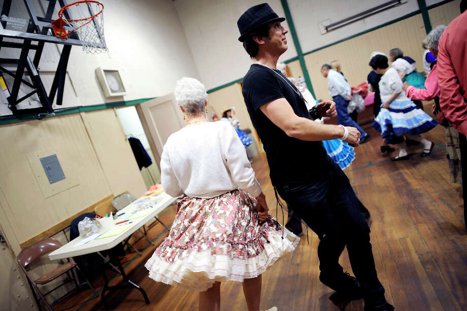1st time square dancer Rob Cassidy(R) dosey-does with another dancer during the introduction dance lessons.  The Caper Cutters Square Dancing Club hosted their weekly dance and beginners lessons at St. Paul's Church in the Sunset District of San Francisco, Monday March 11th, 2013. Photo: Michael Short, Special To The Chronicle / ONLINE_YES