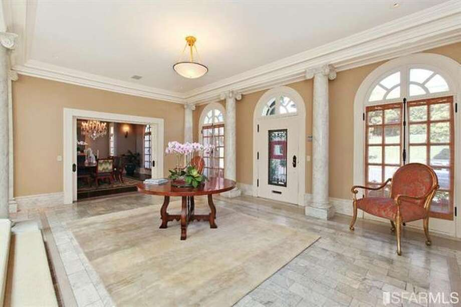 Lots of marble and a peek through to living room. Estately via SFMLS / TRI Coldwell Banker
