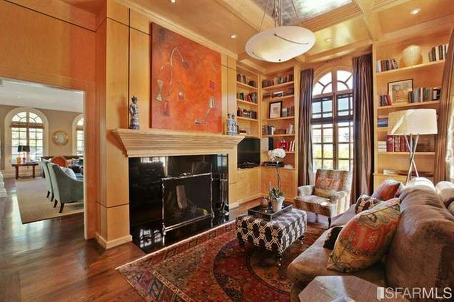This library/conservatory hosts one of four fireplaces. Estately via SFMLS / TRI Coldwell Banker