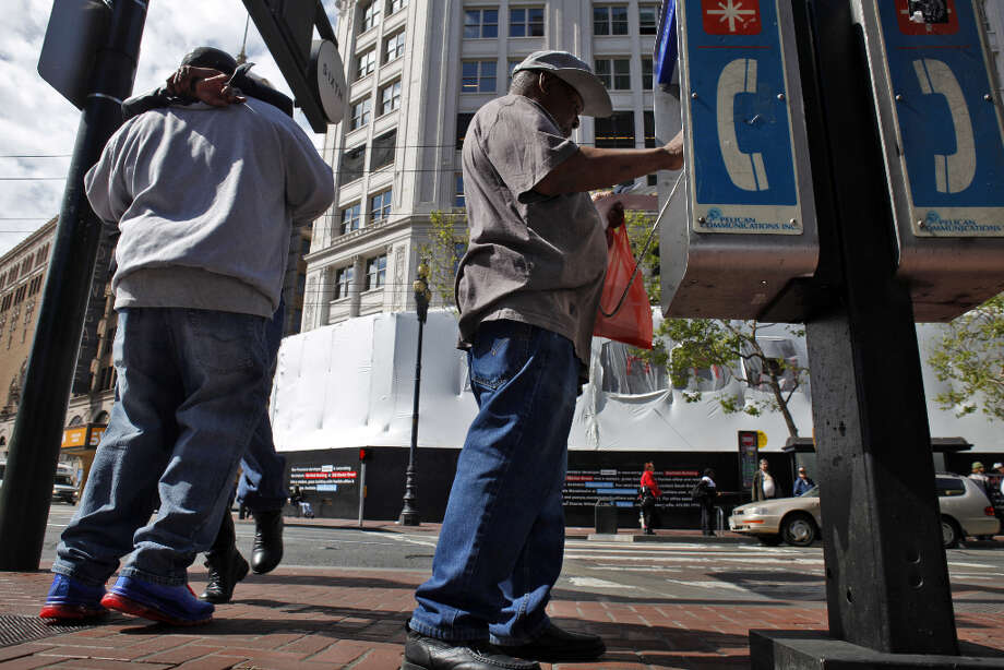 Danny Thomas of San Francisco makes a call on a pay phone on the corner of Sixth Street and Market Street in San Francisco, Calif. Photo: Carlos Avila Gonzalez, The Chronicle / ONLINE_YES