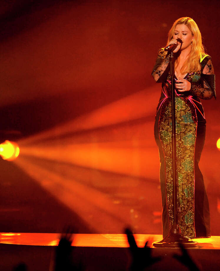 "FILE - In this Dec. 16, 2012 file photo, Kelly Clarkson performs at VH1 Divas at the Shrine Auditorium in Los Angeles. Kelly Clarkson's No. 1 hit, ""Stronger (What Doesn't Kill You),"" is nominated for record of the year at Grammy Awards on Feb. 10, 2013. The song is also up for song of the year and best pop solo performance, and her fifth album, ""Stronger,"" is nominated for best pop vocal album. Photo: Chris Pizzello, CHRIS PIZZELLO/INVISION/AP / Invision"