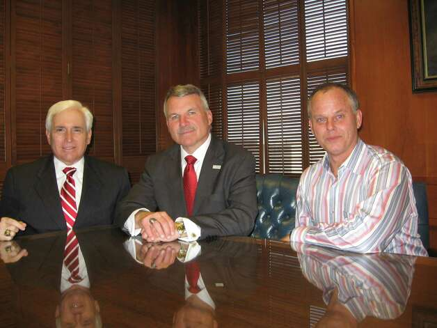 Beaumont lawyers Michael Truncale, left; Michael Getz, center; and David Vann de Cordova, right, discuss how they advised their clients in filing for trustee positions for the Beaumont Independent School District election, which is supposed to be May 11 if appeals by the school board don't delay it. Dan Wallach/The Enterprise Photo: Dan Wallach