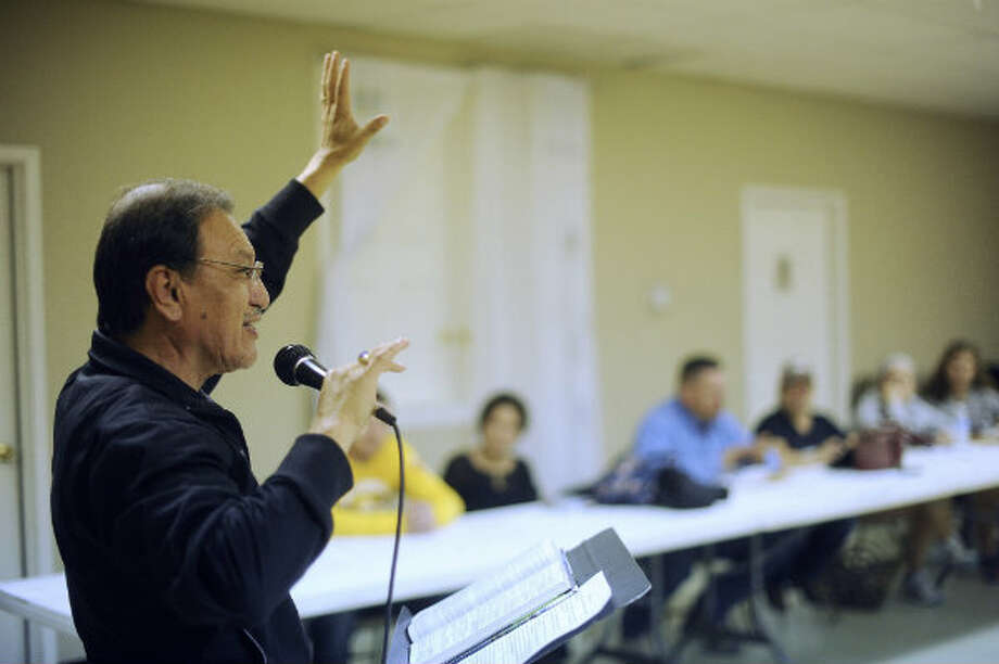 Pastor Juan Florez, leads a mid-week worship service at Hosanna Baptist Church in Poteet, Texas. Several people who work in the Eagle Ford Shale energy sector attend the services.