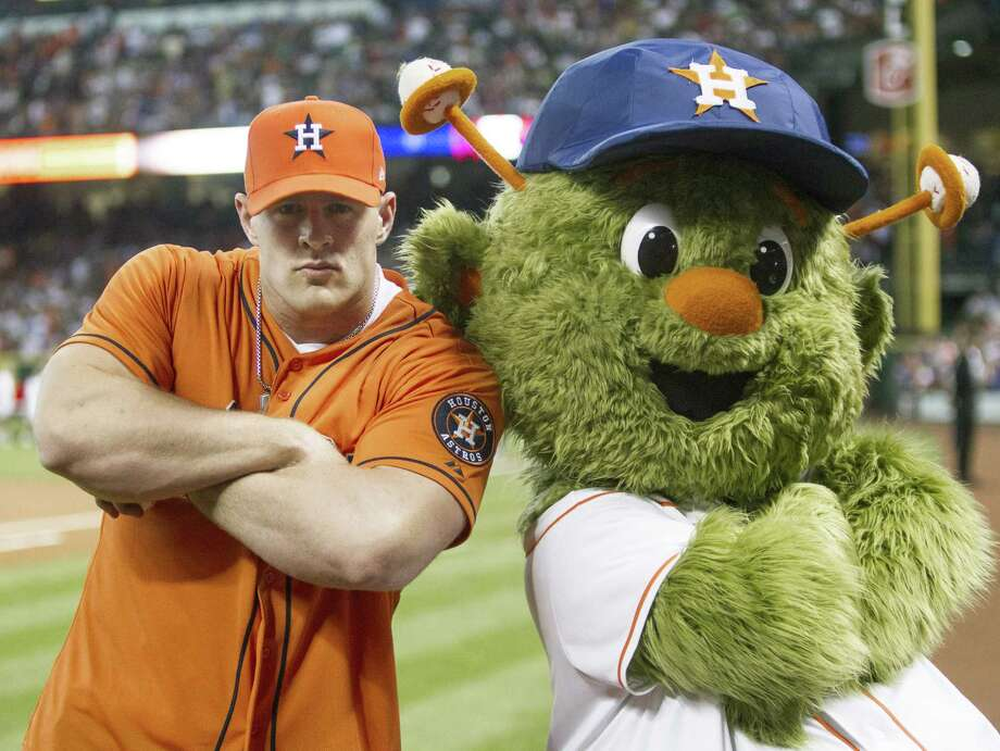 HOUSTON, TX - MARCH 31:  Defensive end J.J. Watt of the Houston Texans poses with Houston Astros mascot Orbit after throwing out the first pitch during opening night at Minute Maid Park as the Texas Rangers played the Houston Astros  on March 31, 2013 in Houston, Texas. Photo: Bob Levey, Getty Images / 2013 Getty Images