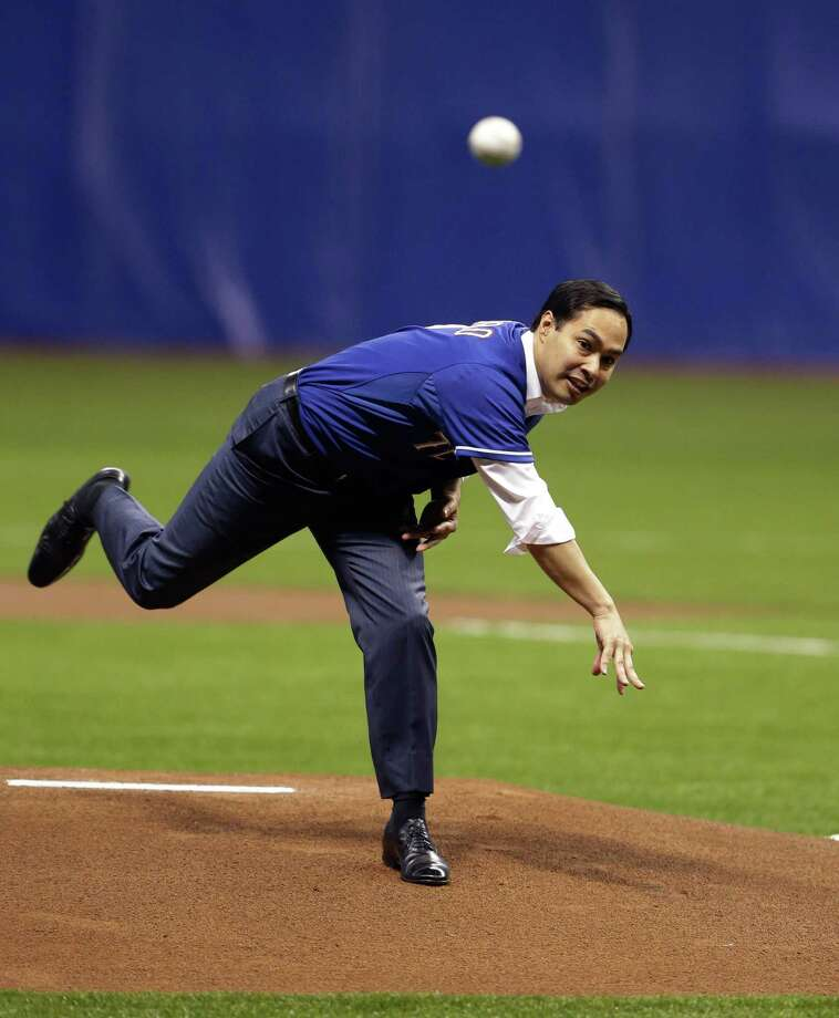 San Antonio Mayor Julian Castro throws out the first pitch prior to an exhibition baseball game between the Texas Ranges and the San Diego Padres, Friday, March 29, 2013, in San Antonio. (AP Photo/Eric Gay) Photo: Eric Gay, Associated Press / AP