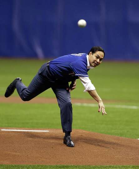 San Antonio Mayor Julian Castro throws out the first pitch prior to an exhibition baseball game betw