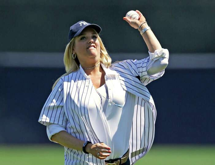 Florida Attorney General Pam Bondi throws out the ceremonial first pitch before a spring training ba