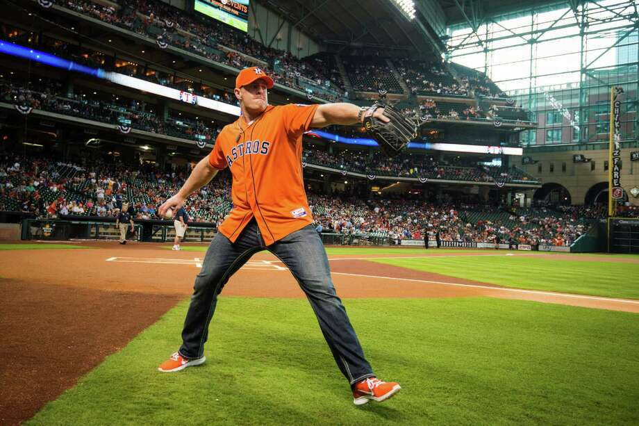 Houston Texans defensive end J.J. Watt prepares to throw out the ceremonial first pitch before a season-opening baseball game between the Houston Astros and the Texas Rangers at Minute Maid Park, Sunday, March 31, 2013, in Houston. (AP Photo/Houston Chronicle, Smiley N. Pool) Photo: Smiley N. Pool, Associated Press / Houston Chronicle