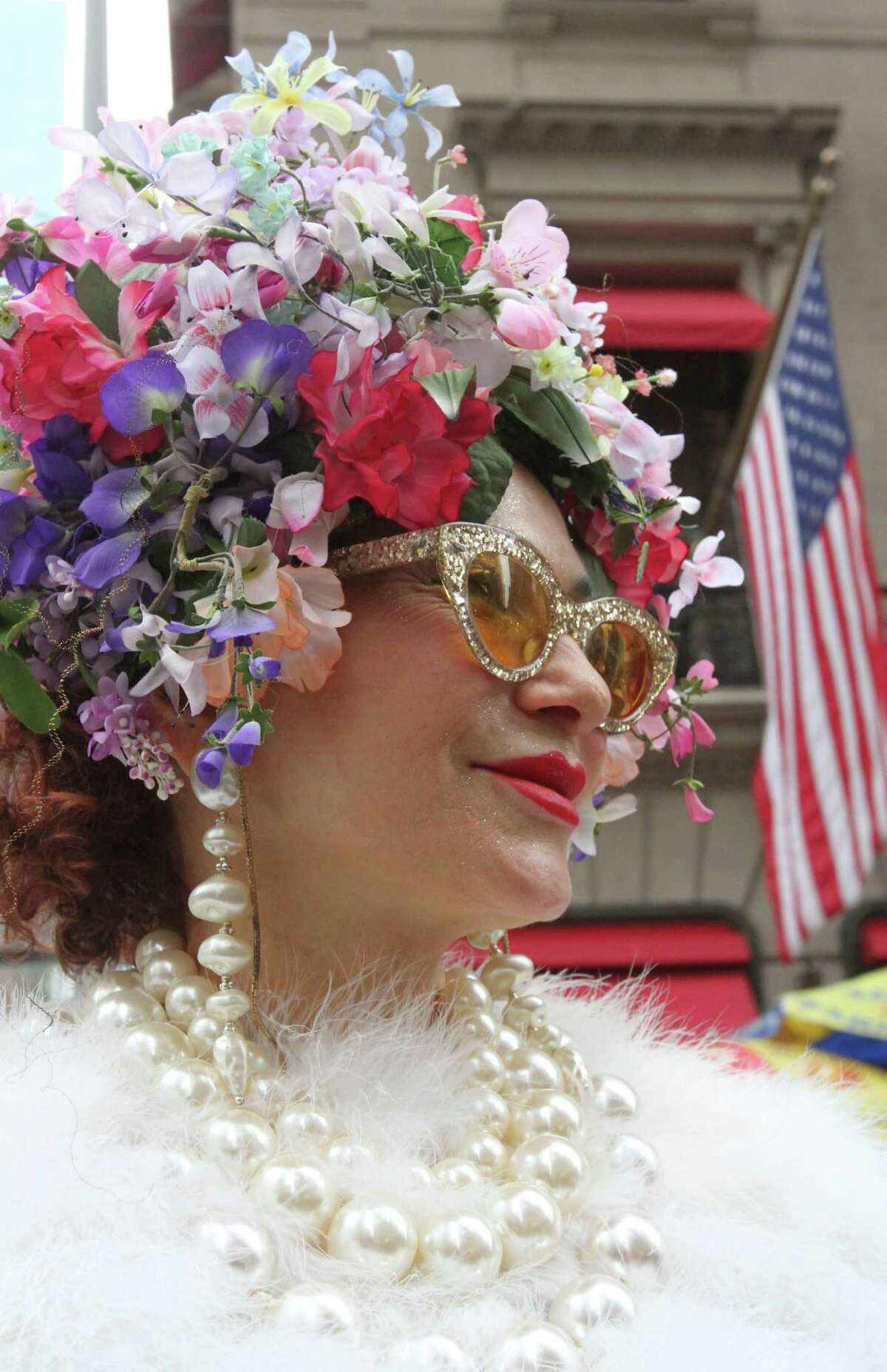 Dressed for the occasion, Purely Patricia Fox, of New York, poses for photographs on New York's Fifth Avenue as she takes part in the Easter Parade, Sunday, March 31, 2013.