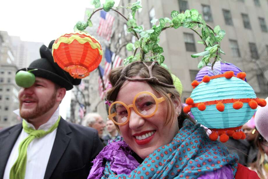Dressed for the occasion, Brooke Biethan, of New York, right, poses for photographs as she and her brother Jay Biethan, of Boston, Mass, left, take part in the Easter Parade on New York's Fifth Avenue, Sunday, March 31, 2013. Photo: Tina Fineberg, AP / FR73987 AP