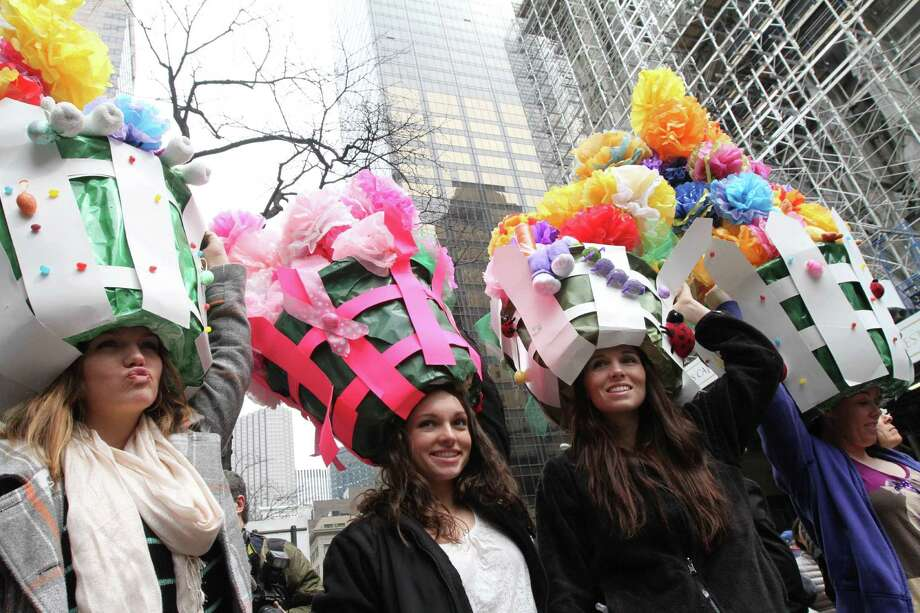 Wearing Easter gardens on their heads, the Woram sisters, from Toms River, N.J., pose for photographs on New York's Fifth Avenue as they take part in the Easter Parade, Sunday, March 31, 2013. Photo: Tina Fineberg, AP / FR73987 AP